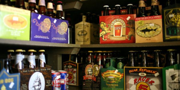 SAN FRANCISCO - MAY 20: Six packs and single bottles of beer are displayed on a shelf at the City Beer...