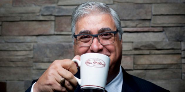Marc Caira, president and chief executive officer of Tim Hortons Inc., stands for a photograph after...