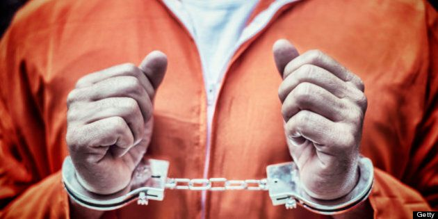 Handcuffed Prisoner in Orange