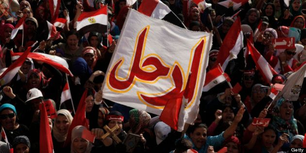 CAIRO, EGYPT - JUNE 30: Egyptian opposition protesters chant during a demonstration in Tahrir Square...