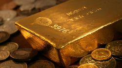 Gold Hits New Record As Investors Flee
