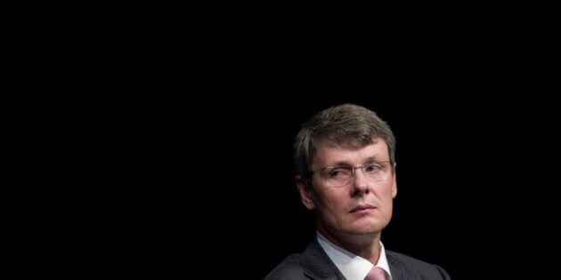 Thorsten Heins, chief executive officer of BlackBerry, listens during the company's annual general meeting in Waterloo, Ontario, Canada, on Tuesday, July 9, 2013. BlackBerrys chances of becoming a viable contender to Apple Inc. and Google Inc. in the smartphone market are dimming amid lackluster demand for its flagship touch-screen device. Photographer: Pawel Dwulit/Bloomberg via Getty Images