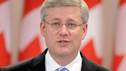 Economists Cast Wary Eye On Harper's Promise Of