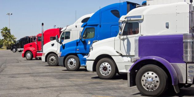 multiple trucks park in a large