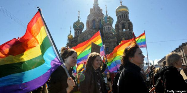 Gay rights activists march in Russia's second city of St. Petersburg May 1, 2013, during their rally...
