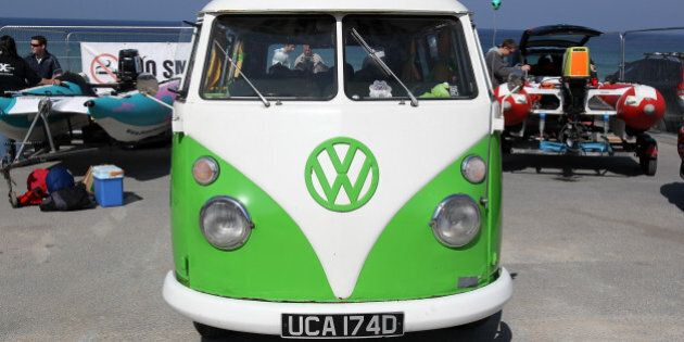 NEWQUAY, ENGLAND - APRIL 23: A classic Volkswagen camper van is parked in the Zapcat power boat team...
