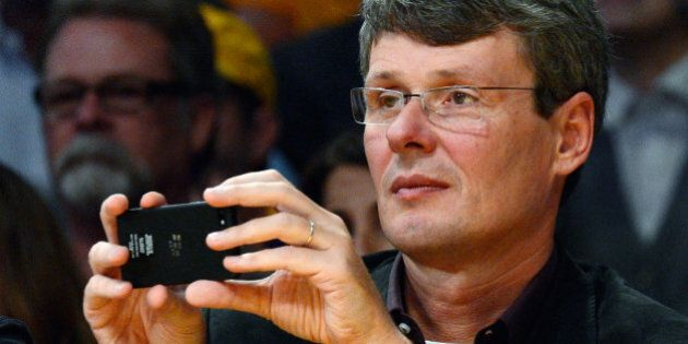LOS ANGELES, CA - NOVEMBER 16:  Thorsten Heins, chief executive officer of Research in Motion, takes a picture with a mobile device during the Los Angeles Lakers and Phoenix Suns NBA basketball game at Staples Center on November 16, 2012 in Los Angeles, California. NOTE TO USER: User expressly acknowledges and agrees that, by downloading and or using this photograph, User is consenting to the terms and conditions of the Getty Images License Agreement.  (Photo by Kevork Djansezian/Getty Images)