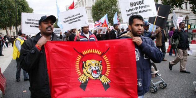 LONDON - OCTOBER 17: Demonstrators display a banner during a march by Tamils from the Embankment to Hyde...