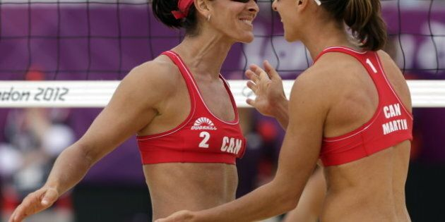 Team Canada's Olympic Women's Beach Volleyball Players Annie Martin, Marie-Andree Lessard Knocked