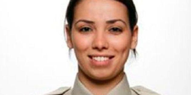Police Officer Dies In Car Part Of GM