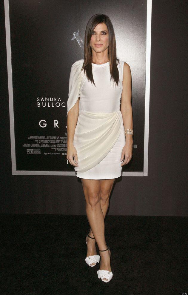 Emma Watson, Sandra Bullock Dazzle In White At 'Gravity' Red Carpet Premiere (VIDEO,