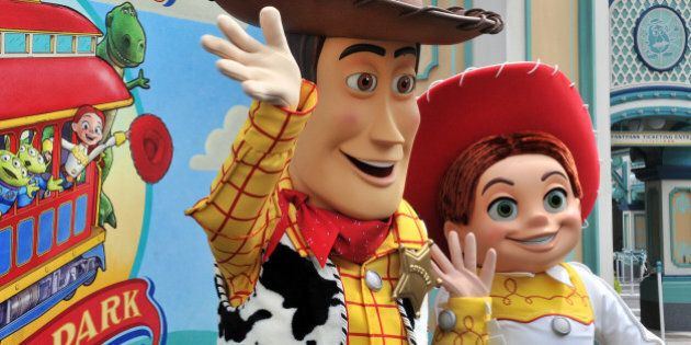 Toy Story characters Woody (L) and Jessie perform at a press preview for the new attraction 'Toy Story...