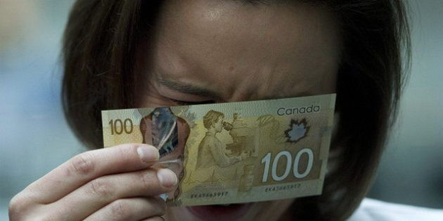 Canada $100 Bills: Image Of Asian-Looking Woman Banned By Bank Of