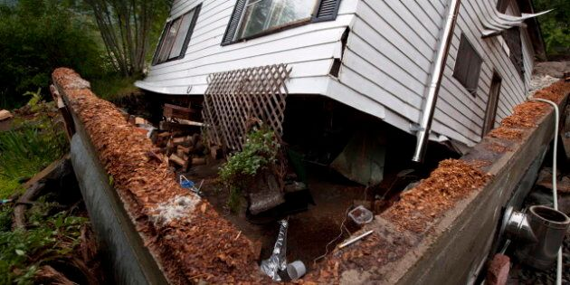 Family Escapes Dangling House In B.C. Flood