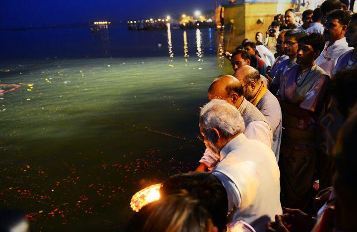"Indian prime minister-elect Narendra Modi performs the ""Ganga Puja"" in Varanasi on May 17, 2014."