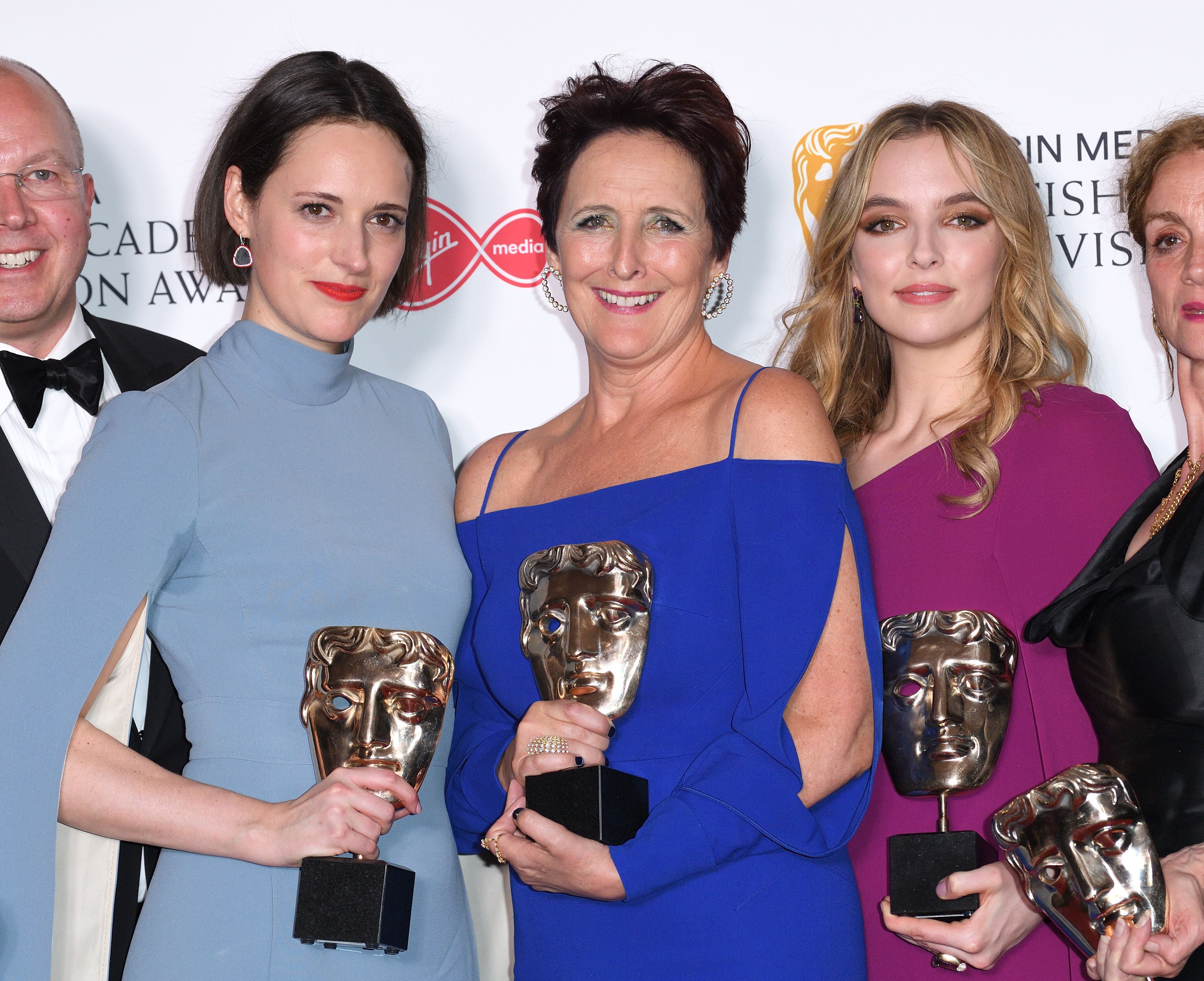 LONDON, ENGLAND - MAY 12: (L-R) Winner of the award for Drama Series for 'Killing Eve', Phoebe Waller-Bridge, winner of the Supporting Actress award for 'Killing Eve', Fiona Shaw and winner of the Best Leading Actress award for 'Killing Eve', Jodie Comer pose in the Press Room at the Virgin TV BAFTA Television Award at The Royal Festival Hall on May 12, 2019 in London, England. (Photo by Karwai Tang/WireImage)