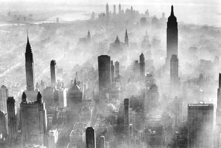 View of the city skyline partially obscured by smog, New York City, 1973.