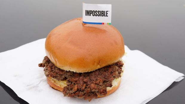 FILE- This Jan. 11, 2019, file photo shows the Impossible Burger, a plant-based burger containing wheat protein, coconut oil and potato protein among it's ingredients in Bellevue, Neb. From soy-based sliders to ground lentil sausages, plant-based meat substitutes are surging in popularity. Growing demand for healthier, more sustainable food is one reason people are seeking plant-based meats. (AP Photo/Nati Harnik, File)
