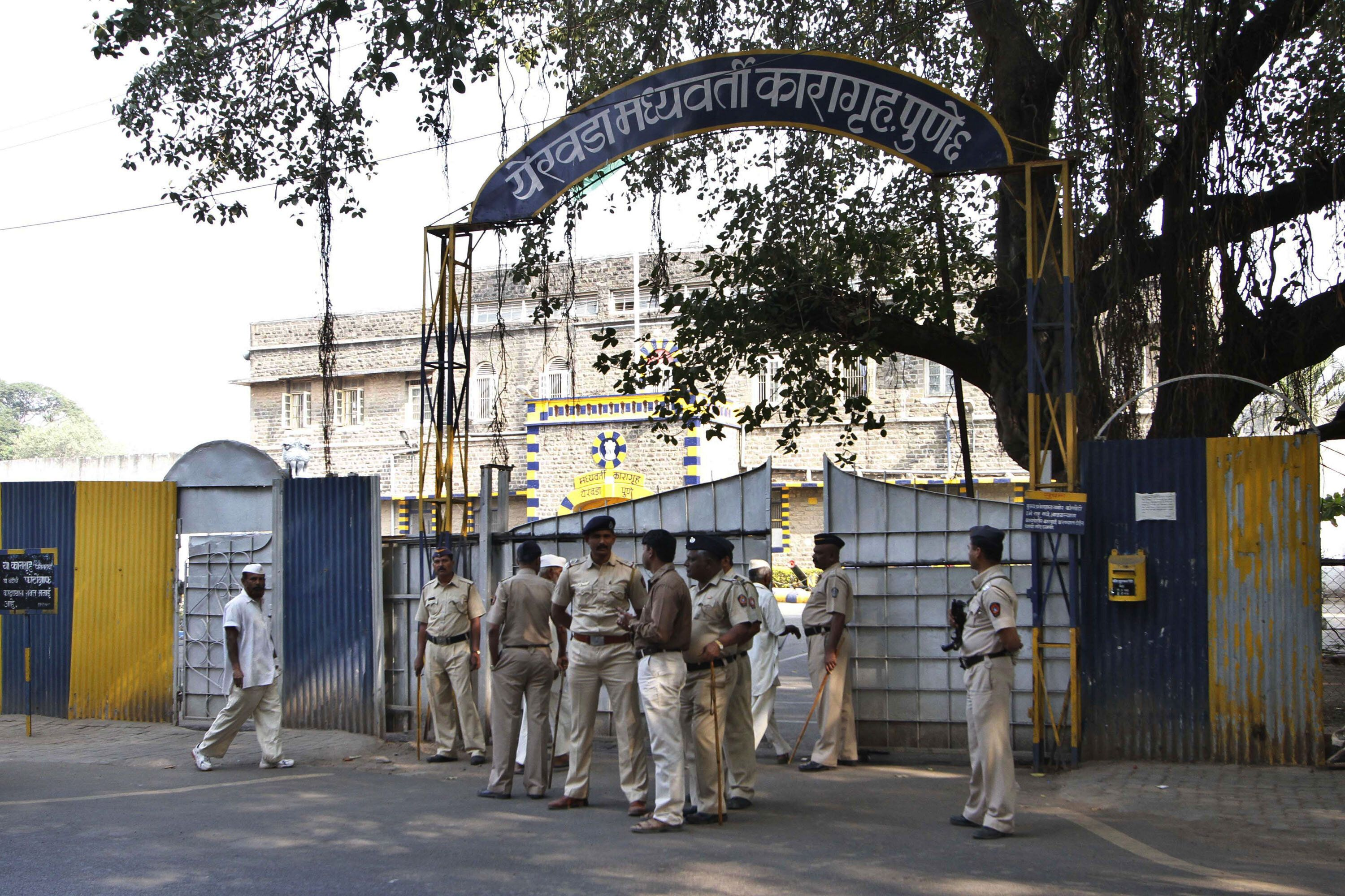 Indian policemen stand outside the Yerwada Jail in
