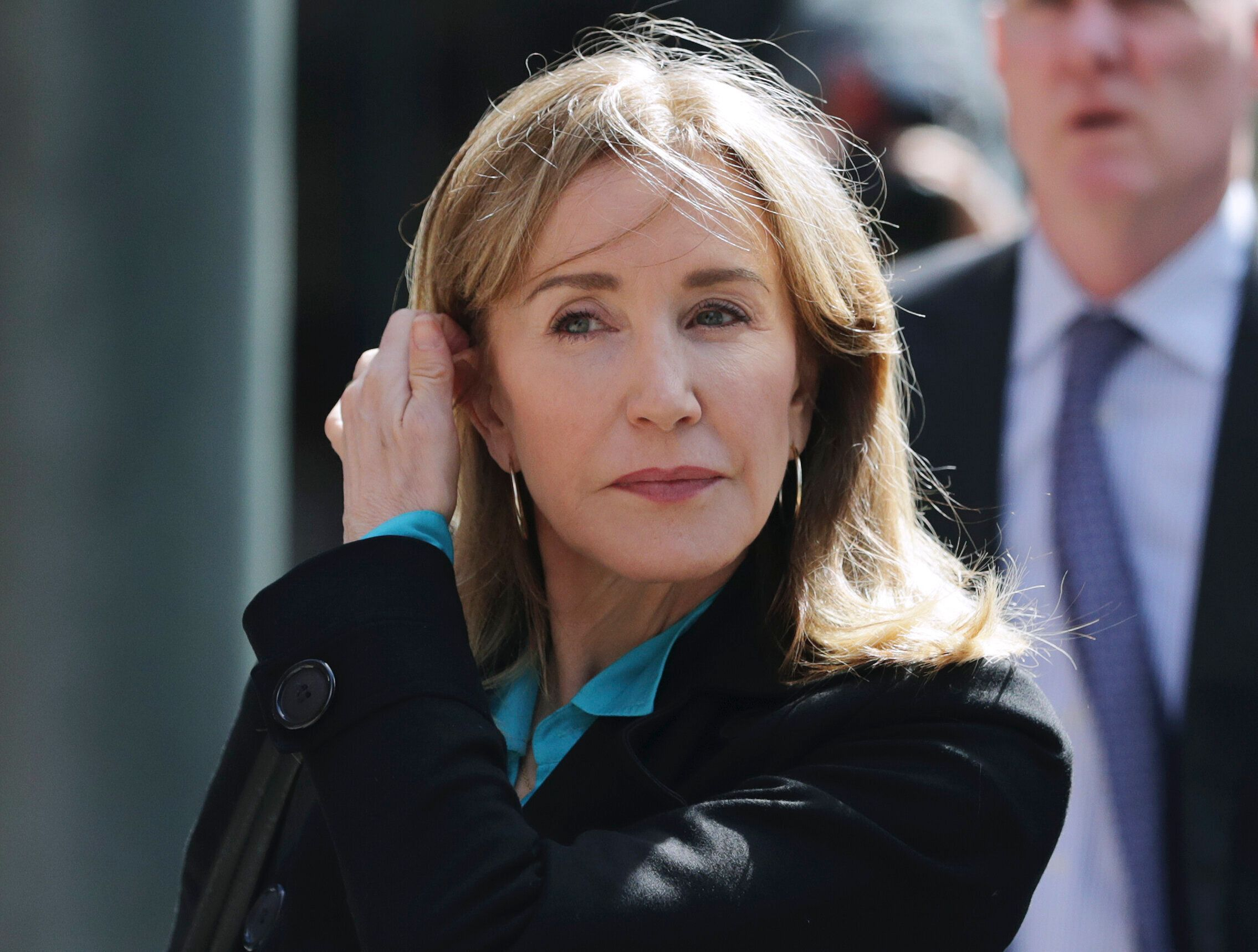 FILE - In this April 3, 2019 file photo, actress Felicity Huffman arrives at federal court in Boston to face charges in a nationwide college admissions bribery scandal. On Monday, May 13, 2019, Huffman is expected to plead guilty to charges that she took part in the cheating scam. (AP Photo/Charles Krupa, File)