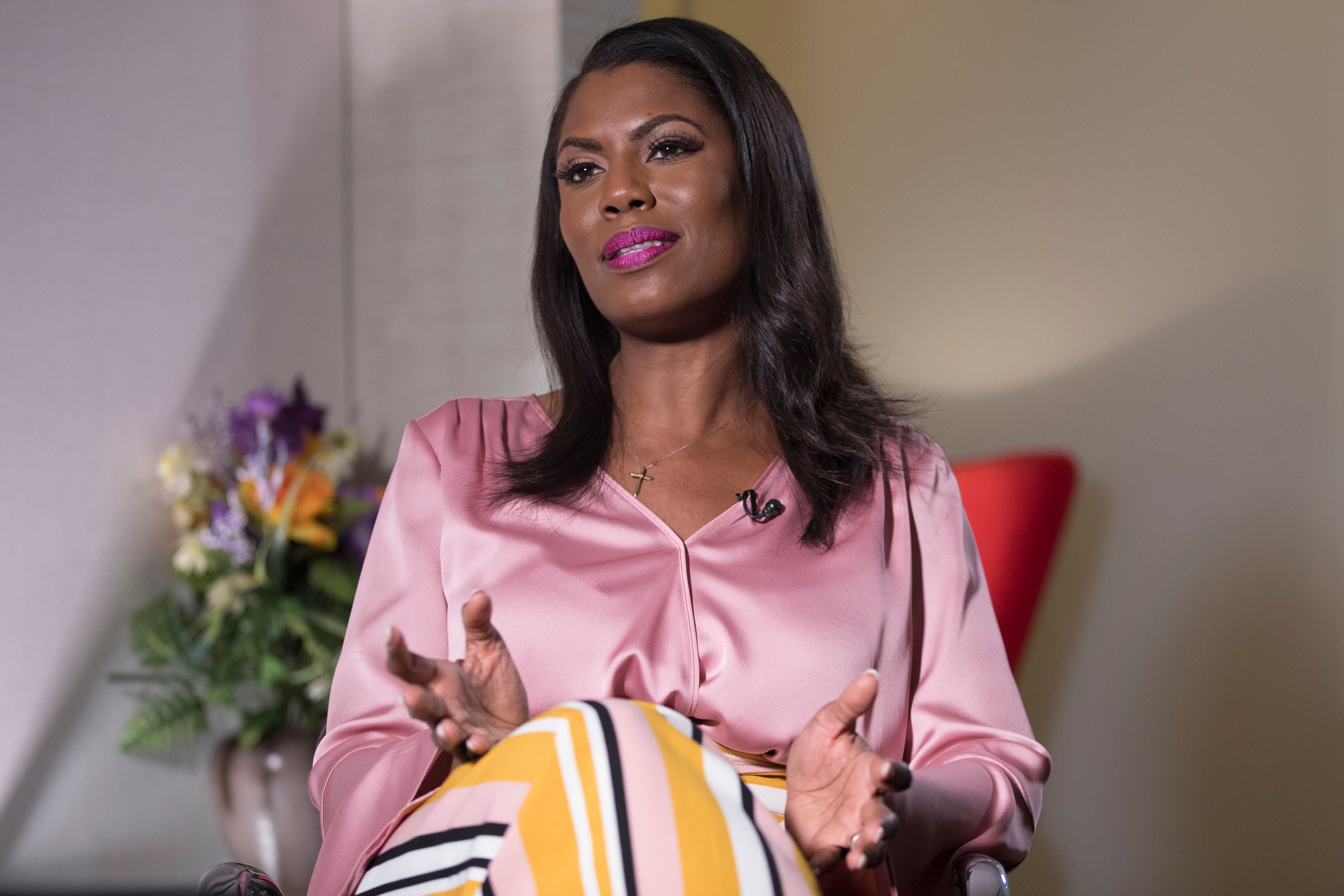 "Former White House staffer Omarosa Manigault Newman speaks during an interview with The Associated Press, Tuesday, Aug. 14, 2018, in New York. Manigault Newman declared she ""will not be silenced"" by President Donald Trump, remaining defiant as her public feud with her former boss shifted from a war of words to a possible legal battle. (AP Photo/Mary Altaffer)"