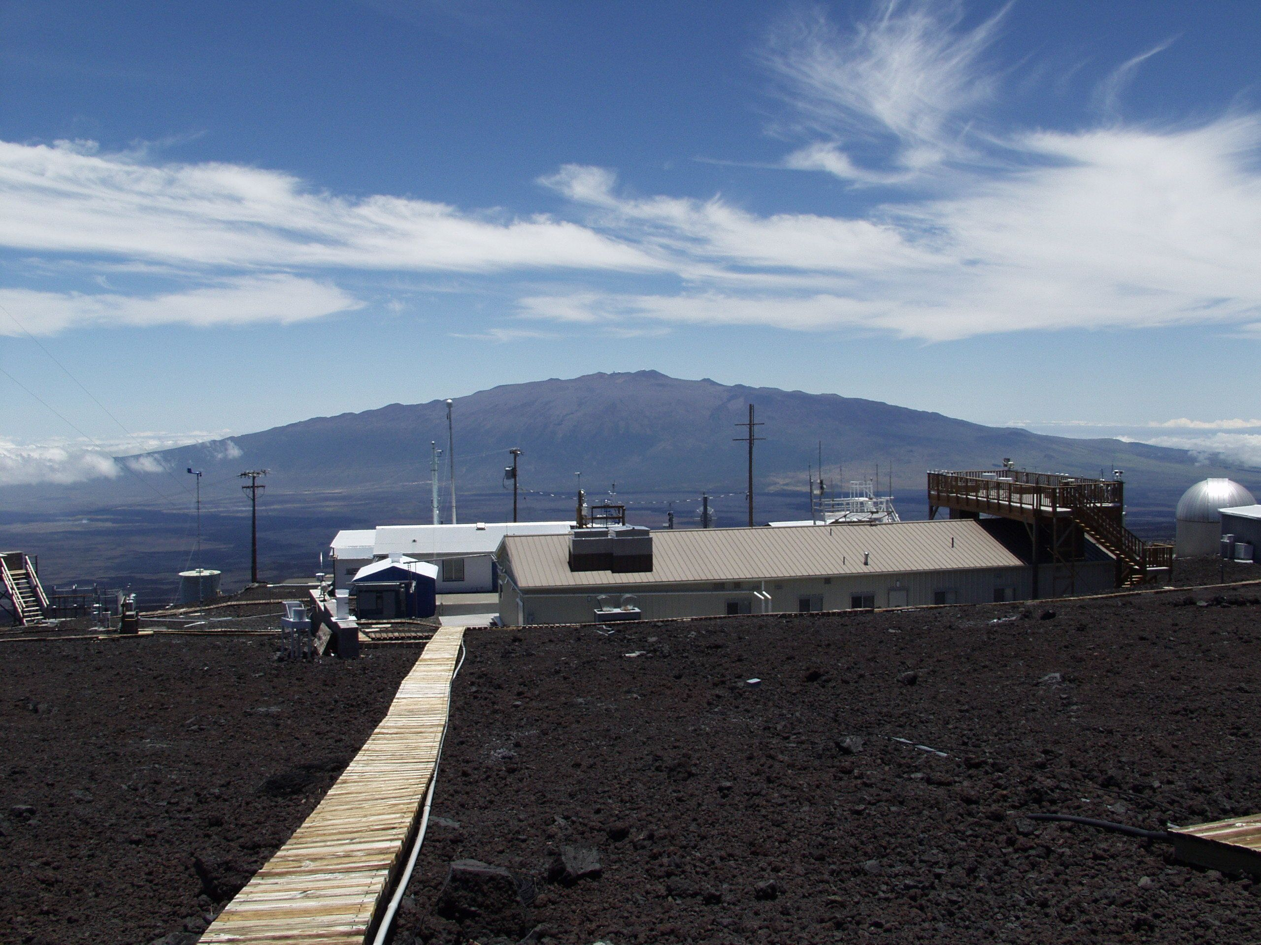 This photo provided NOAA, shows NOAA's Mauna Loa Observatory in Hawaii. Measurements show the amount of heat-trapping carbon dioxide in the air jumped by the biggest amount on record last month, a rise amplified by El Nino, scientists say. Carbon dioxide levels increased by 4.16 parts per million in April compared to a year earlier, according to readings at Mauna Loa in Hawaii. Until this year, the biggest increase was 3.7 ppm. Records go back to 1950. (NOAA via AP)