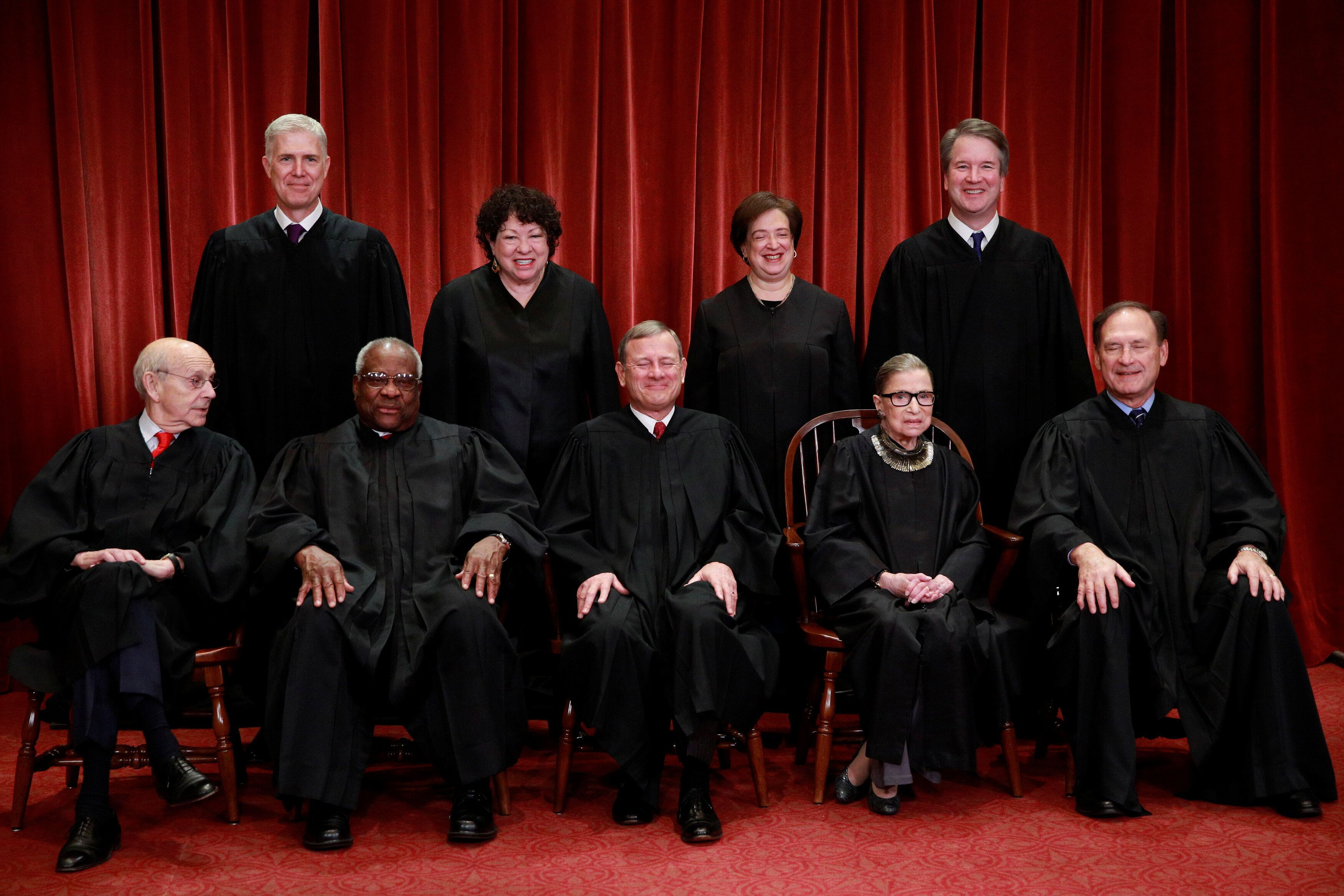 U.S. Supreme Court justices pose for their group portrait at the Supreme Court in Washington, U.S., November 30, 2018. Seated (L-R): Associate Justice Stephen Breyer, Associate Justice Clarence Thomas, Chief Justice of the United States John G. Roberts, Associate Justice Ruth Bader Ginsburg and Associate Justice Samuel Alito, Jr. Standing behind (L-R): Associate Justice Neil Gorsuch, Associate Justice Sonia Sotomayor, Associate Justice Elena Kagan and Associate Justice Brett M. Kavanaugh.  REUTERS/Jim Young
