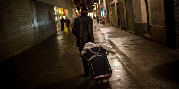BARCELONA, SPAIN - JANUARY 11: A homeless walks the street after dining at the 'El Chiringuito de Dios'...