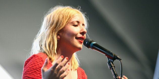 INDIO, CA - APRIL 11:  Musician Katie Stelmanis of Austra performs onstage during day 1 of the 2014 Coachella Valley Music & Arts Festival at the Empire Polo Club on April 11, 2014 in Indio, California.  (Photo by Imeh Akpanudosen/Getty Images for Coachella)