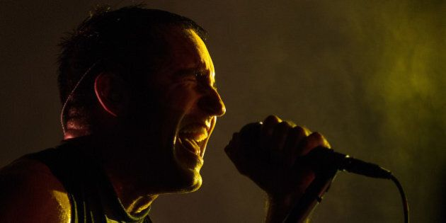 FILE - This Aug. 2, 2013 file photo, Trent Reznor, lead singer of the band Nine Inch Nails performs at...