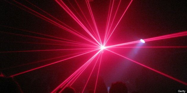 people clubbing with laser