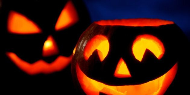 Scary halloween pumpkins jack-o-lantern on black