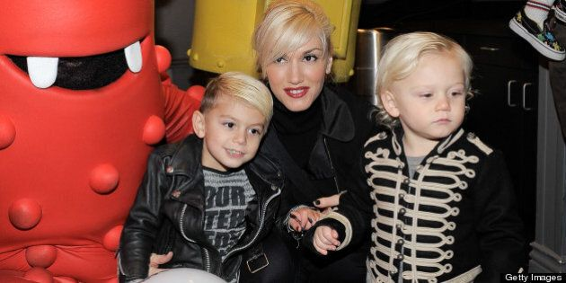 Singer Gwen Stefani with sons Kingston (L) and Zuma Rossdale meets YO GABBA GABBA! characters backstage...