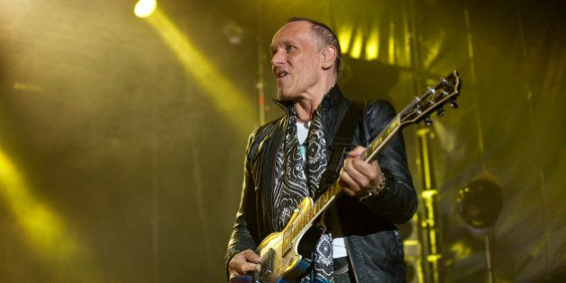 BARCELONA, SPAIN - JUNE 24: Vivian Campbell of Def Leppard performs on stage at Poble Espanyol on June 24, 2013 in Barcelona, Spain. (Photo by Jordi Vidal/Redferns via Getty Images)