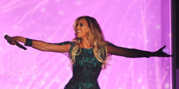 LONDON, ENGLAND - FEBRUARY 19: Beyonce performs onstage at The BRIT Awards 2014 at The O2 Arena on February 19, 2014 in London, England. (Photo by Dave J Hogan/Getty Images)