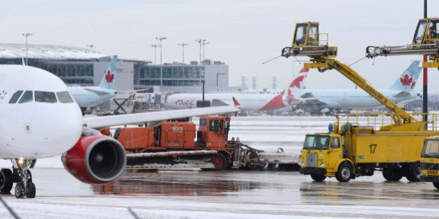 TORONTO, ON - JANUARY 20: Air Canada planes get de-iced on the tarmac by crews at Pearson International...