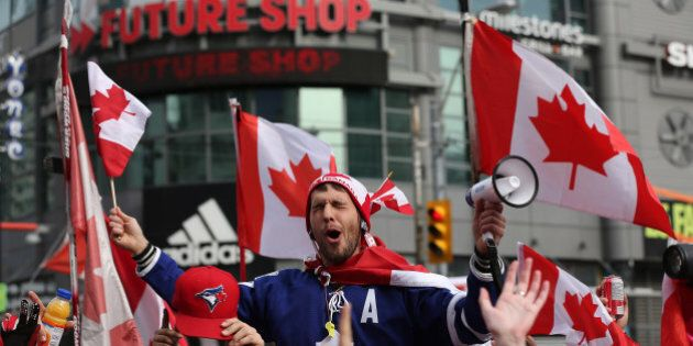 TORONTO, ON- FEBRUARY 23 - Canadian fans celebrate the men's hockey Olympic gold medal by shutting down the intersection at Yonge-Dundas Square In Toronto. February 23, 2014. (Steve Russell/Toronto Star via Getty Images)