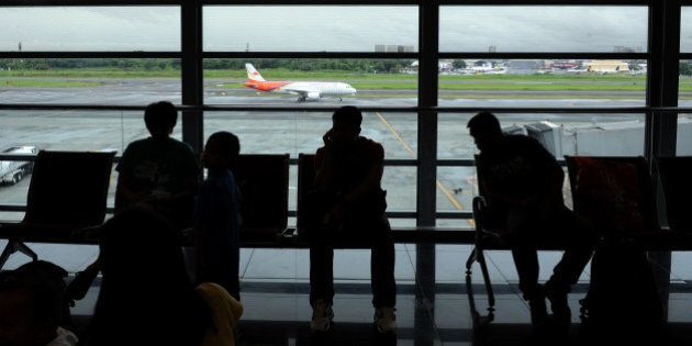 This photo taken on July 21, 2012 shows passengers waiting for their flight at the terminal building...
