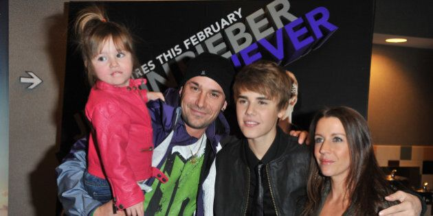 (L-R) Sister Jazmyn Bieber, father Jeremy Bieber, singer Justin Bieber and mother Pattie Lynn Mallete...