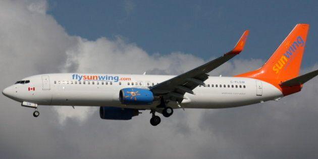 description 1 A Sunwing Airlines Boeing 737-8HX landing at Vancouver International Airport 1 Sunwing...