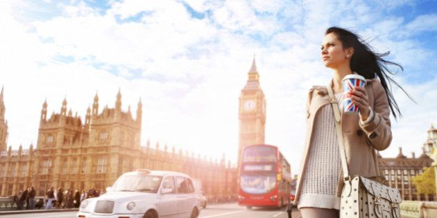 Female tourist walking with luggage at Big Ben in London. See my other photos from London: