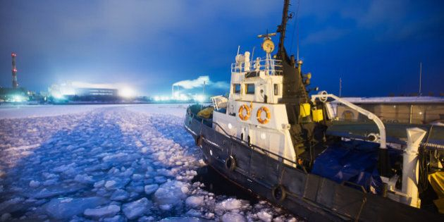 The Icebreaker ship trapped in ice tries to break and leave