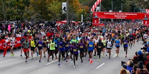 TORONTO, ON - October 18, 2015 - The top runners leave the start line during the Toronto Waterfront Marathon...