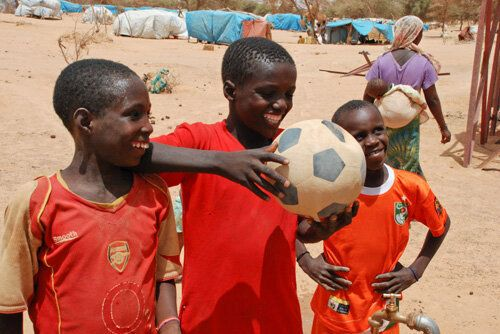 The Child Behind the Soccer