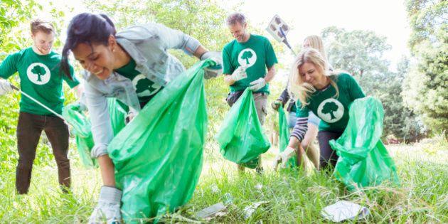 Environmentalist volunteers picking up trash in