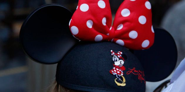 A guest wearing Minnie Mouse ears waits for the Splash Mountain ride at Walt Disney Co.'s Disneyland...