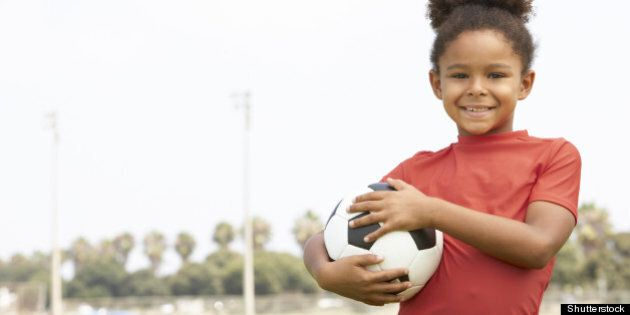 young girl in football