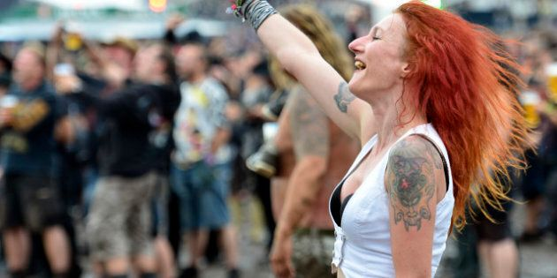 WACKEN, GERMANY - AUGUST 03:  A festival goer enjoys the Wacken Open Air heavy metal music fest on August 3, 2012 in Wacken, Germany. Approximately 75,000 heavy metal fans from all over the world have descended on the north German village of 1,800 residents for the annual three-day fest.  (Photo by Patrick Lux/Getty Images)