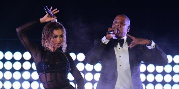 Beyonce Knowles and Jay-Z perform on stage for the 56th Grammy Awards at the Staples Center in Los Angeles,...