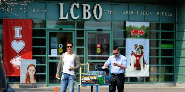 TORONTO, ON - JULY 13:    People leaving the LCBO  as beer sales have spiked during the hot and dry weather.......shots of  people leaving the LCBO with there wares on Queens Quay at Cooper st.        (Colin McConnell/Toronto Star via Getty Images)